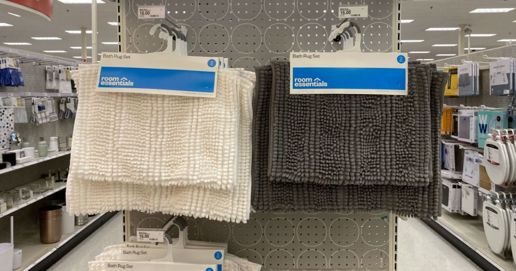 white and gray rugs hanging on rack