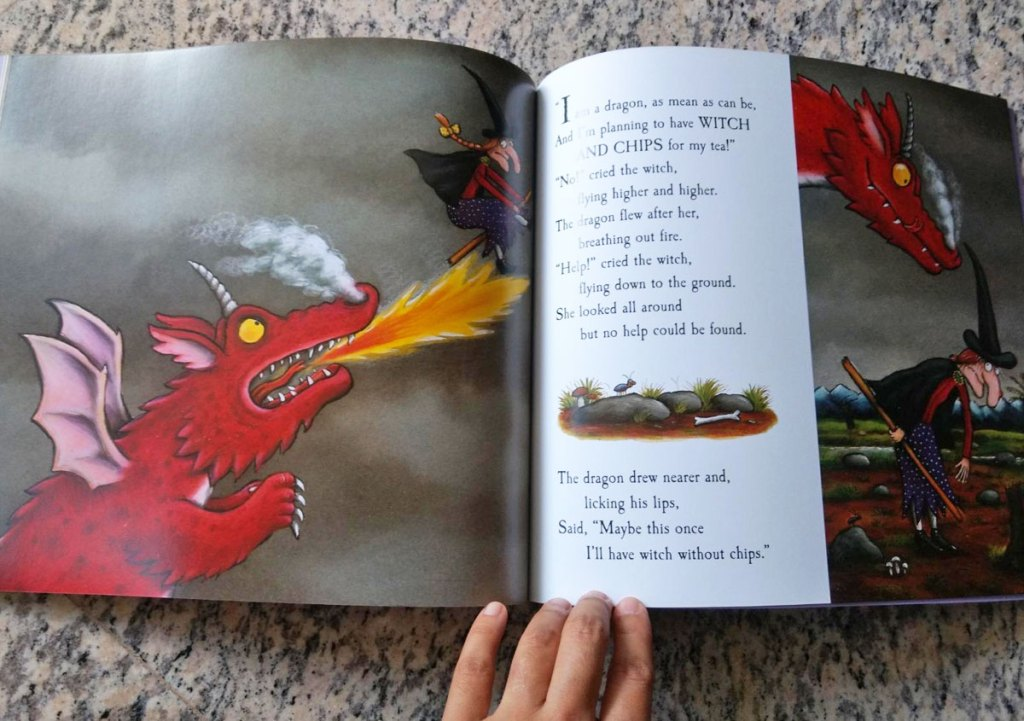 room on the broom kids book opened showing red dragon breathing fire