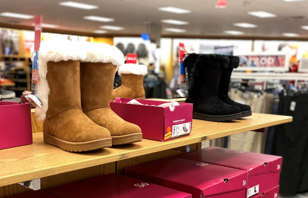 women's boots and shoe boxes on shelves at Kohl's