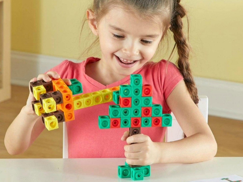 girl playing with STEM building blocks