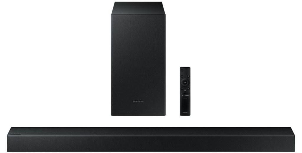 black soundbar, subwoofer, and remote