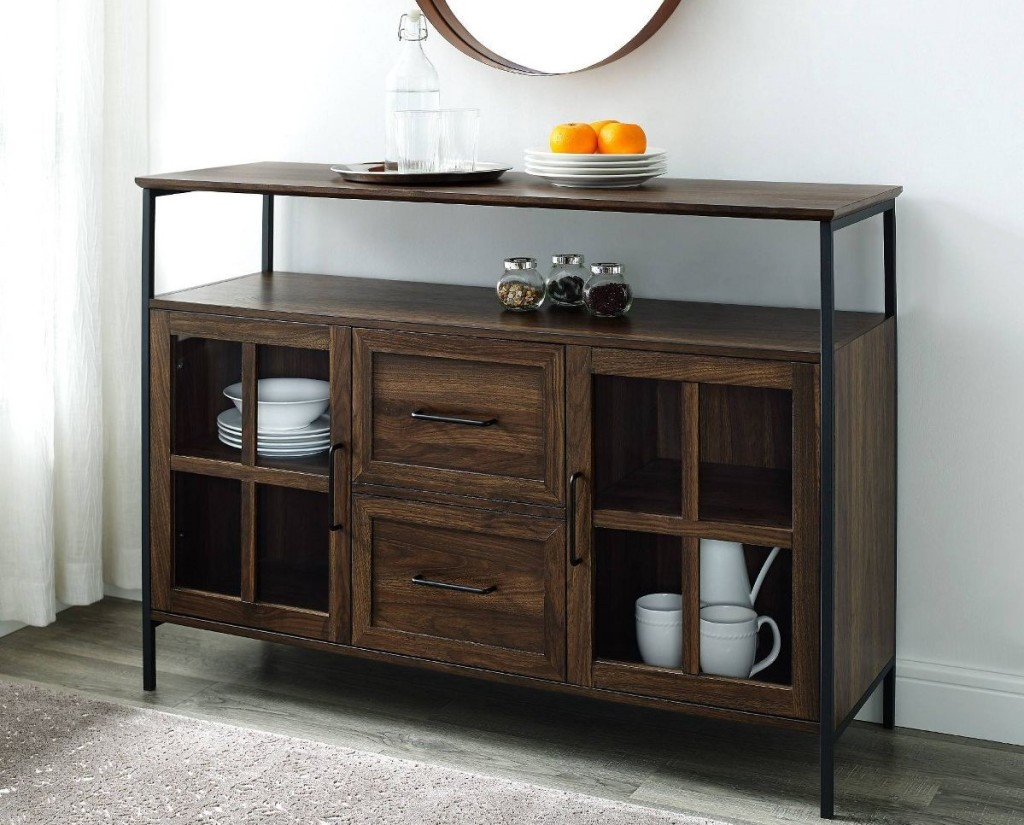wooden buffet with dinnerware on it