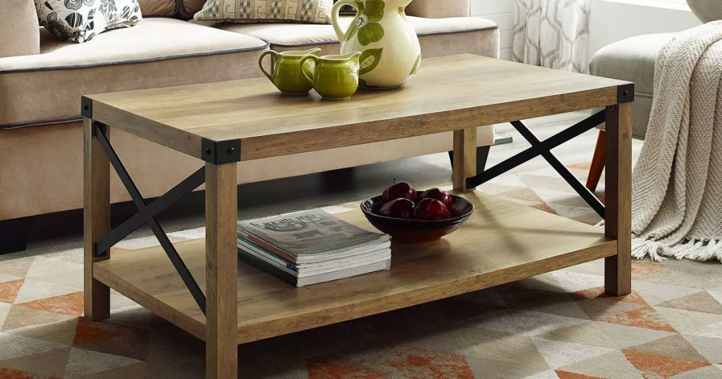 oak finish coffee table in living room with metal X sides
