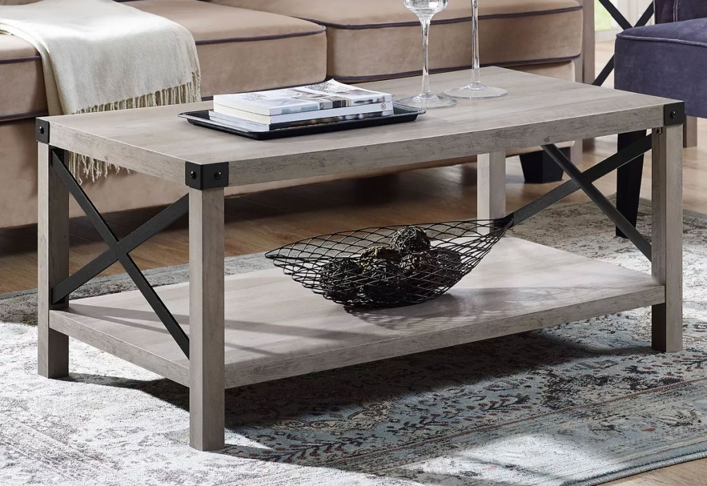 grey wash coffee table in living room with metal X sides