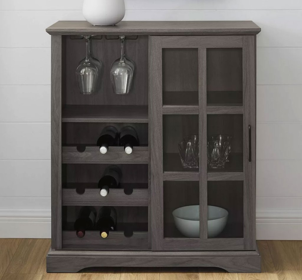 bar cabinet with glass door, shelves, and nine notches to hold bottles of wine