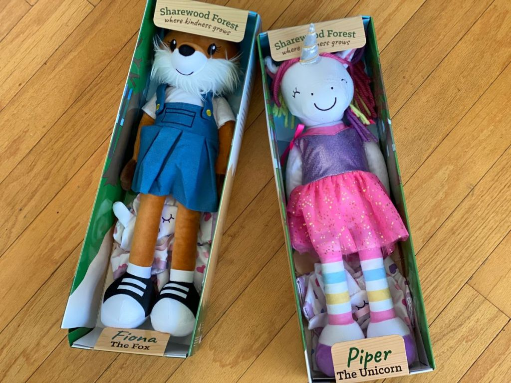 two plush toys in boxes