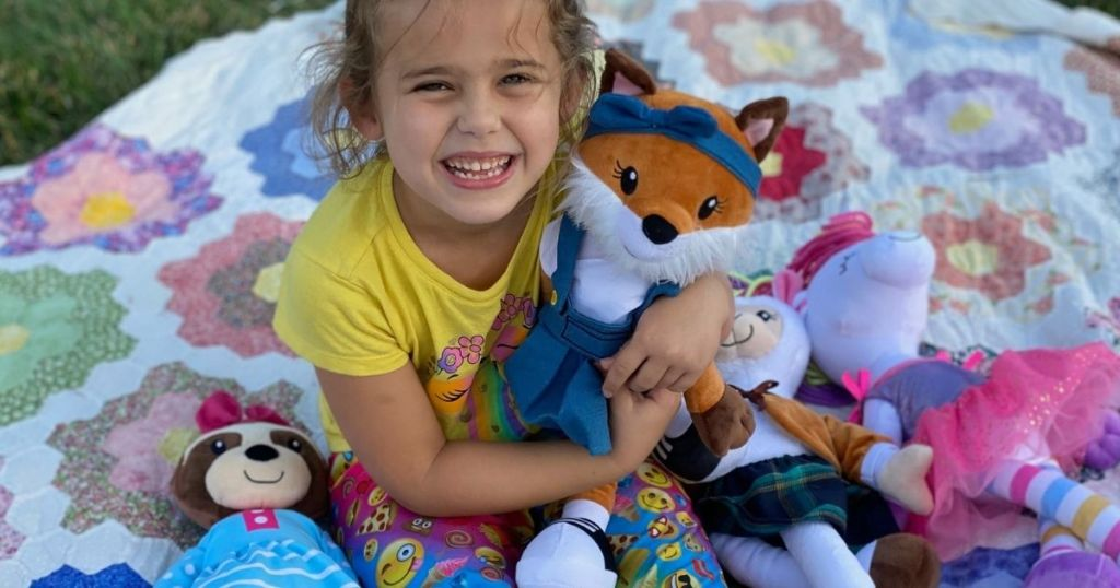 girl holding a toy fox