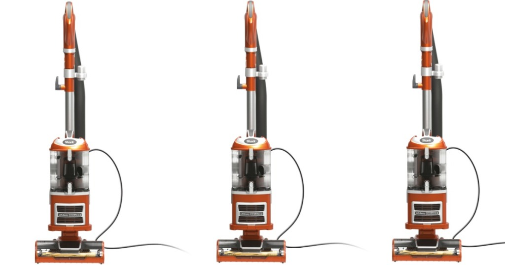 Three gray and orange vacuum cleaners