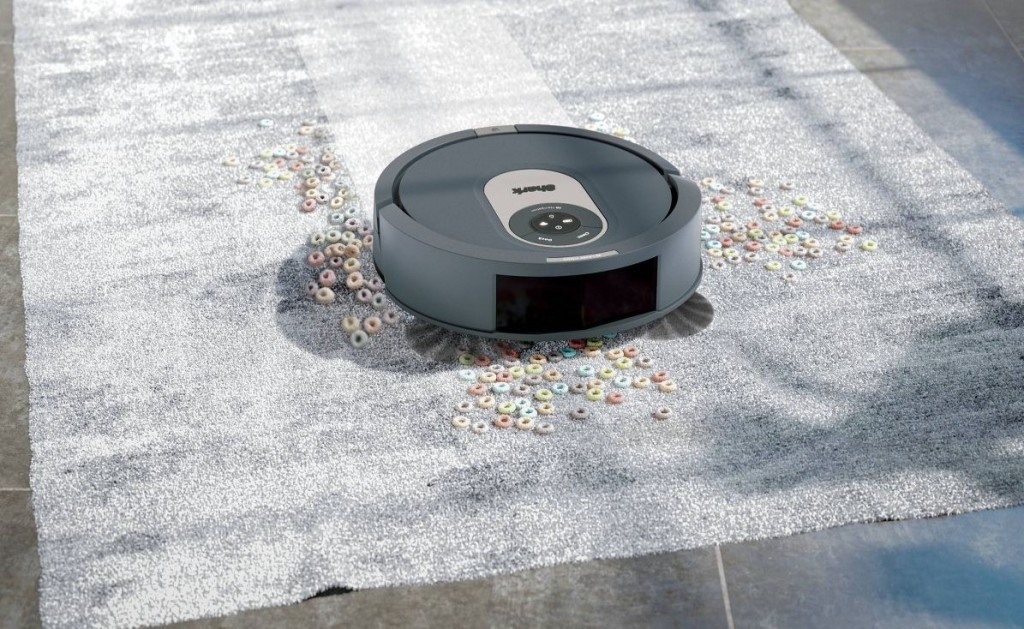 robot vacuum cleaning up cereal