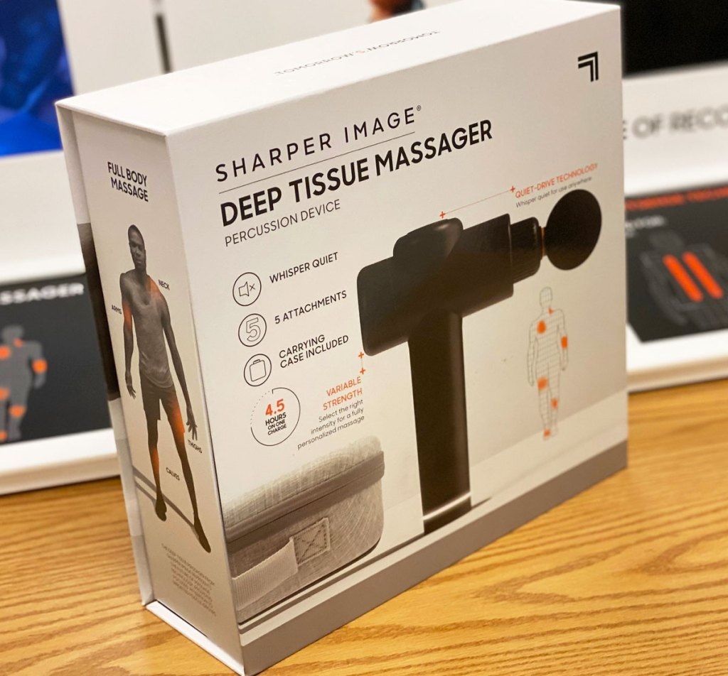 sharper image massage gun in box on a wood display table at kohl's