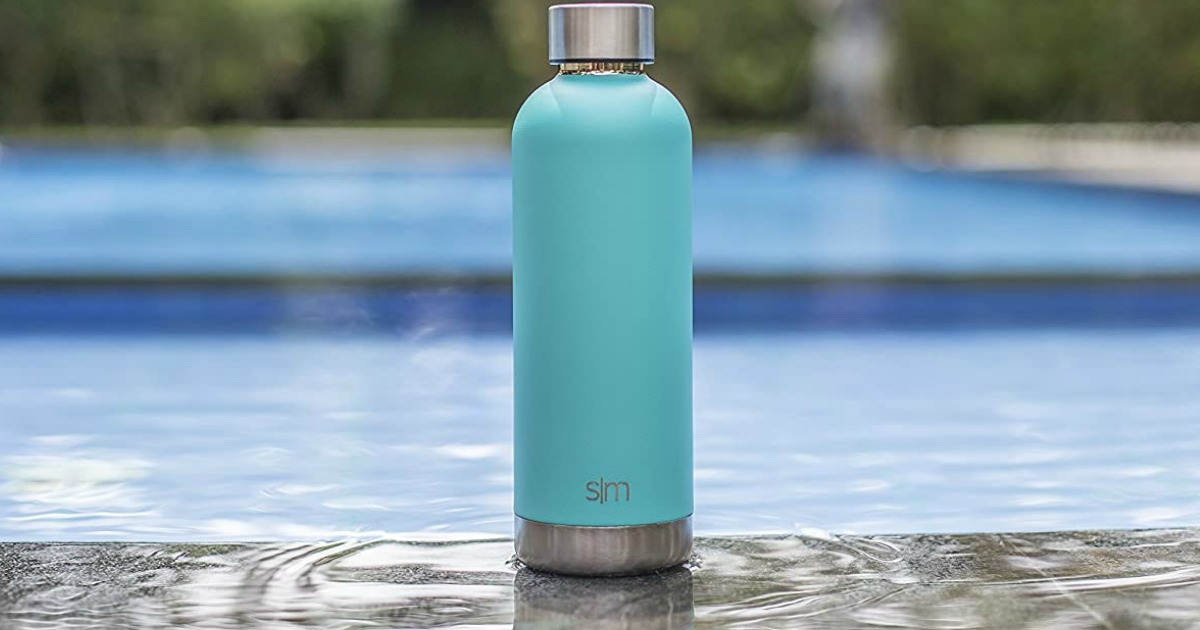 Simple Modern 17oz Stainless Steel Sports Water Bottle in teal near a pool