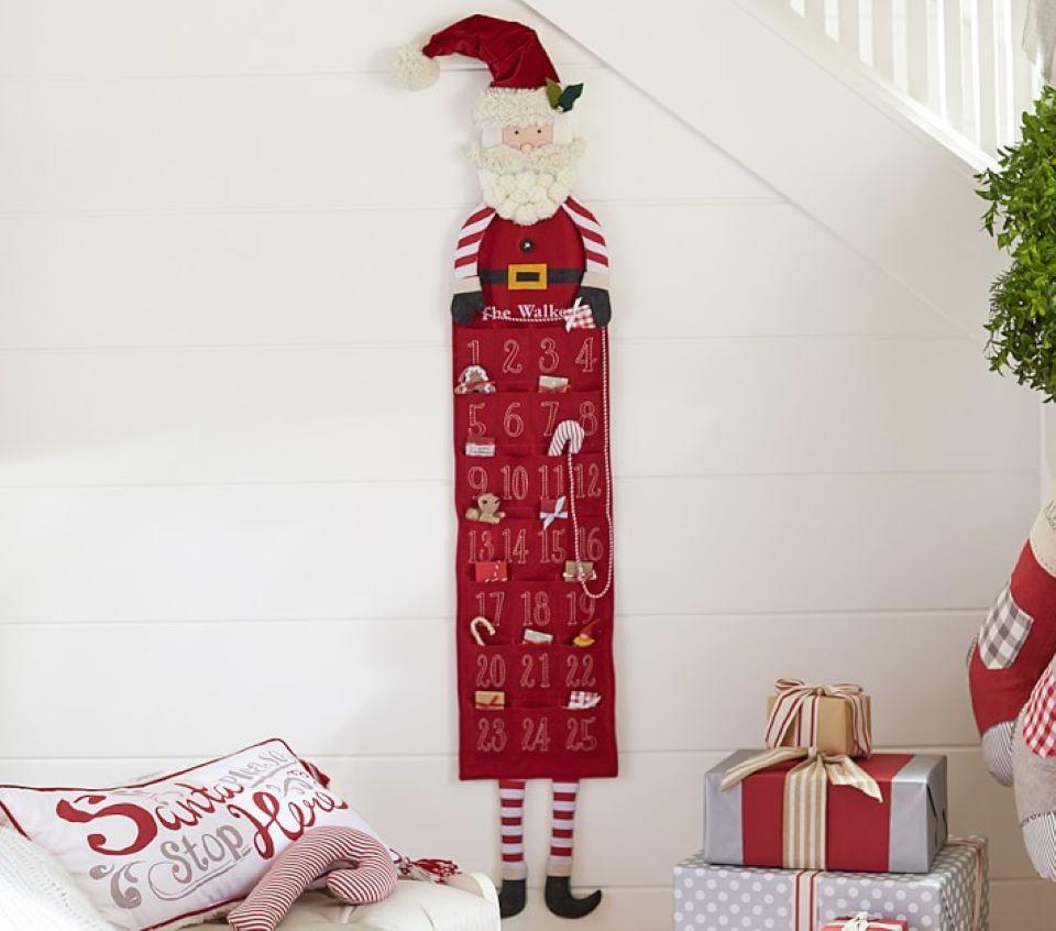 Skinny Santa Advent calendar hanging on the wall