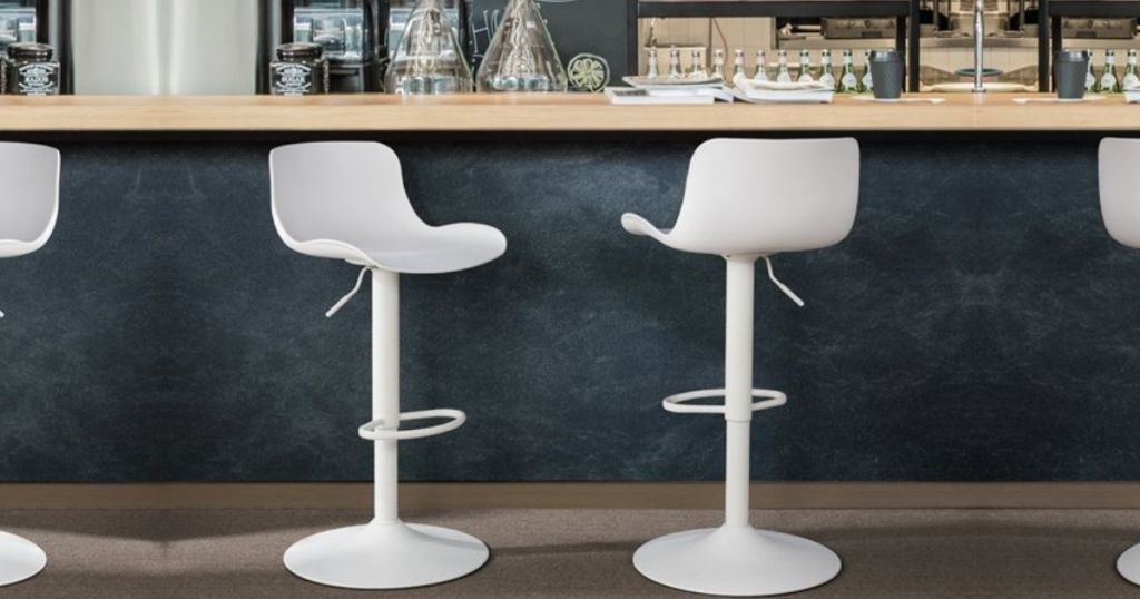 two adjustable bar stools at a cafe counter