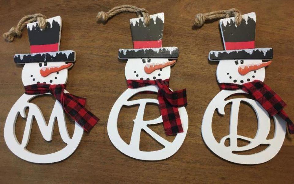 three snowman ornaments