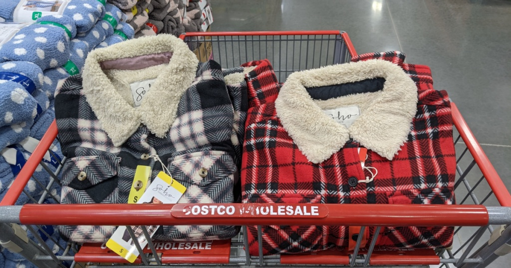 black flannel jacket and red flannel jacket in store cart in store