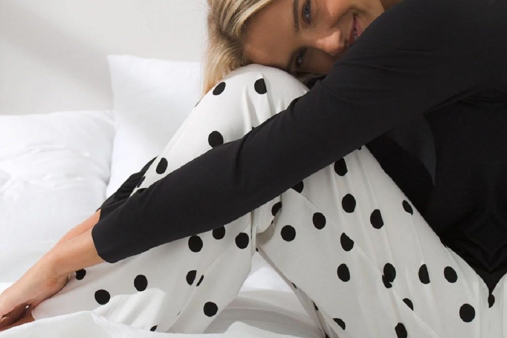 woman wearing black and white pajamas