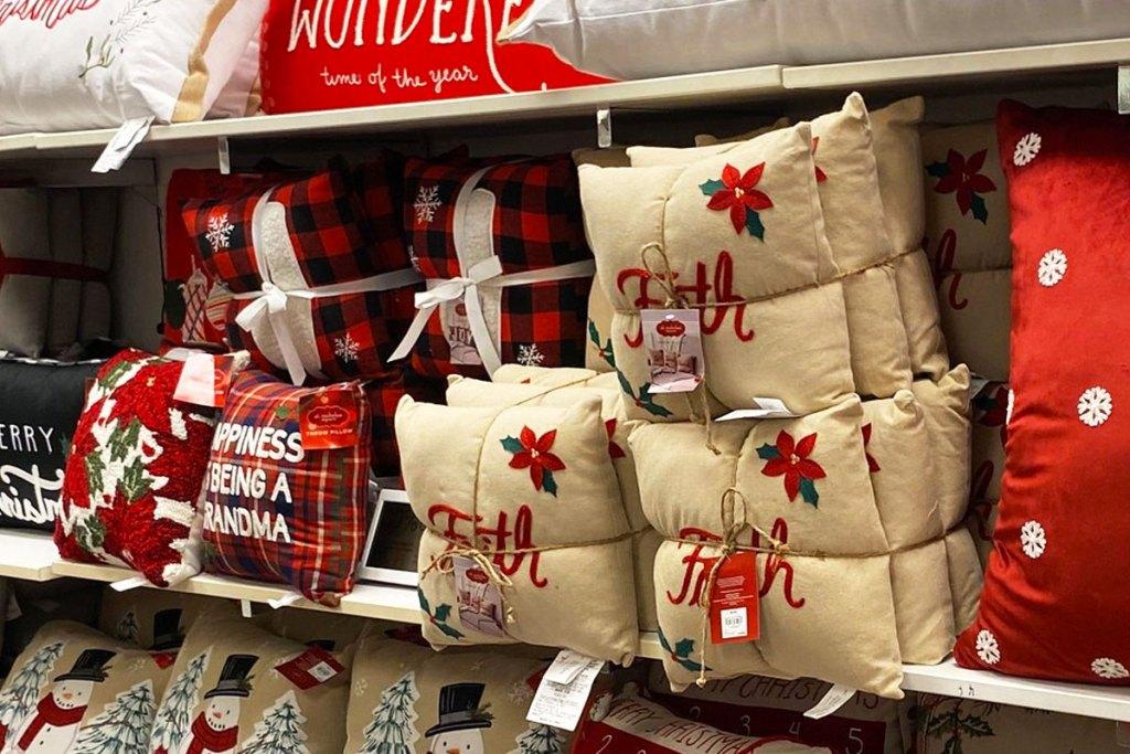christmas themed throw pillows on display at kohls