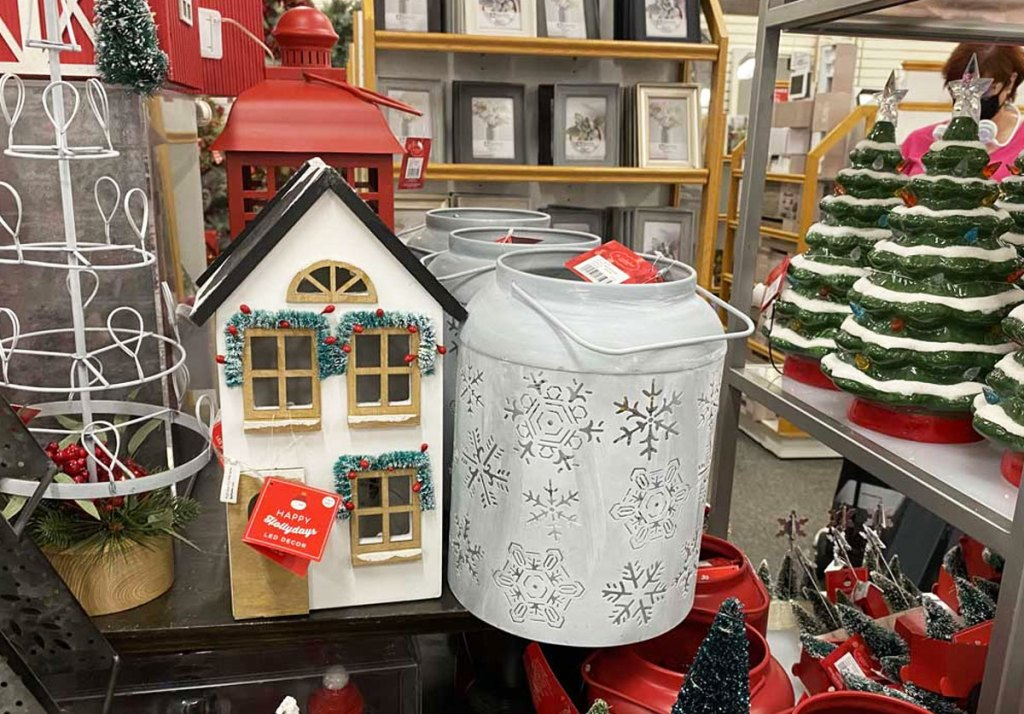 wood white house and metal latnern with snowflake cutout designs on display at kohls