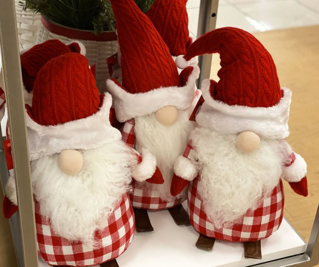 three red and white christmas theme gnomes on display at kohls