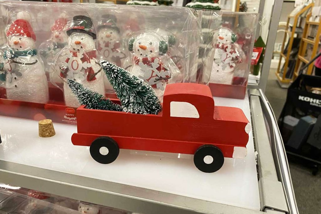 wooden red truck with christmas tree in the bed
