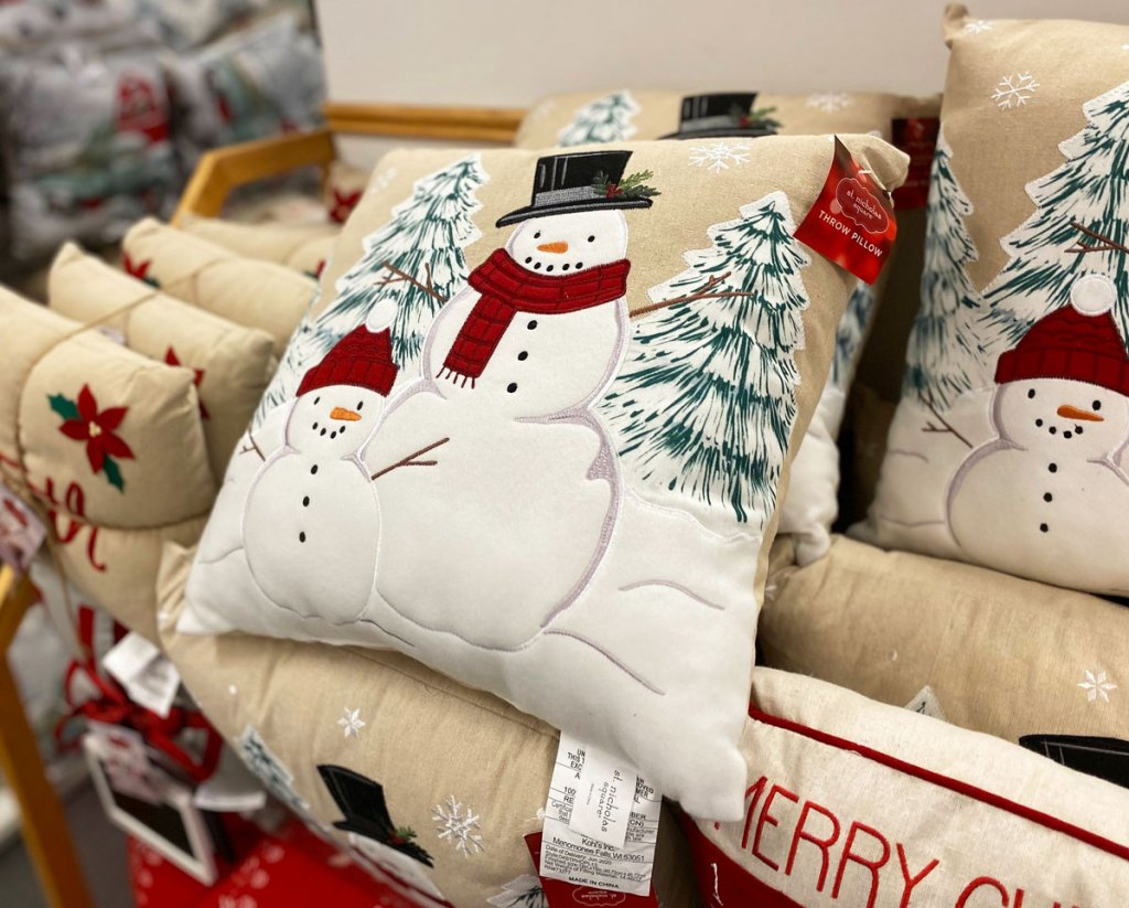 christmasy snowman throw pillow on stack of other throw pillows at kohl's