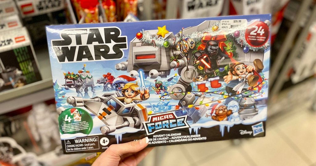 woman holding up the box for a star wars toy advent calendar