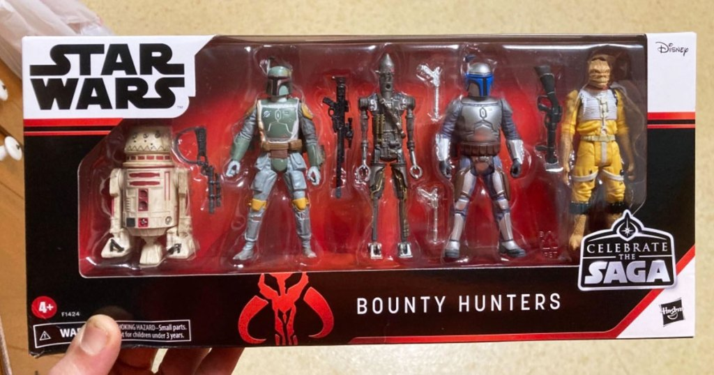 person holding up a box of 5 star wars bounty hunters collectable figurines