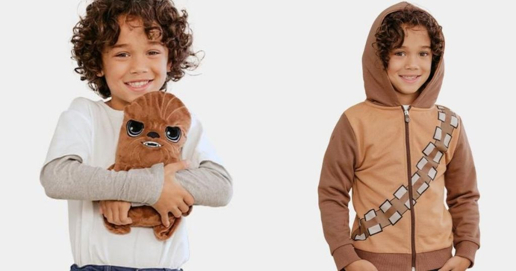 boy holding a plush next to a boy in a sweatshirt