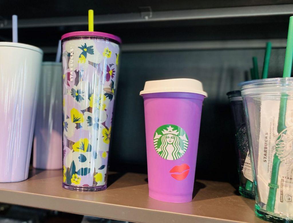 Starbucks cups on shelf