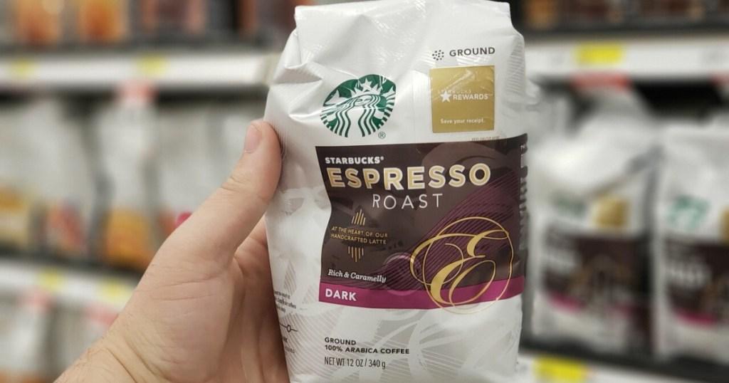 hand holding bag of espresso dark roast ground coffee in store