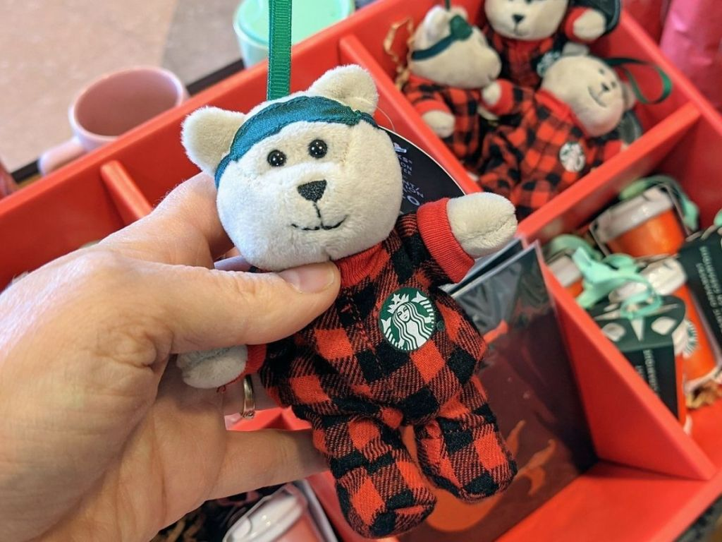 Person holding Starbucks Holiday Bear Ornament
