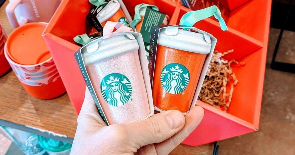 Person holding mini Starbucks Cups Ornaments