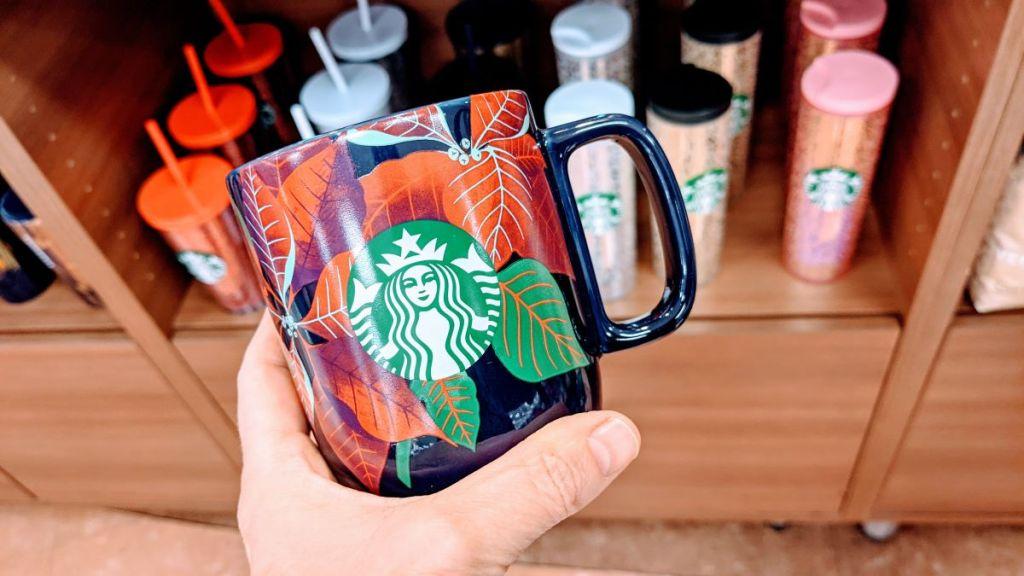 hand holding a Starbucks mug