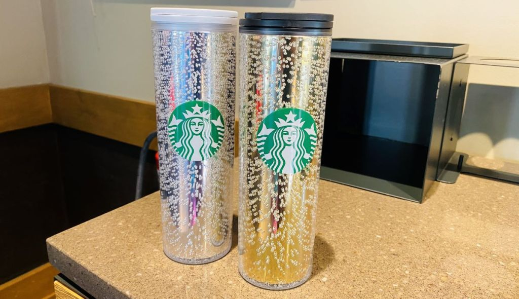 two Starbucks tumblers