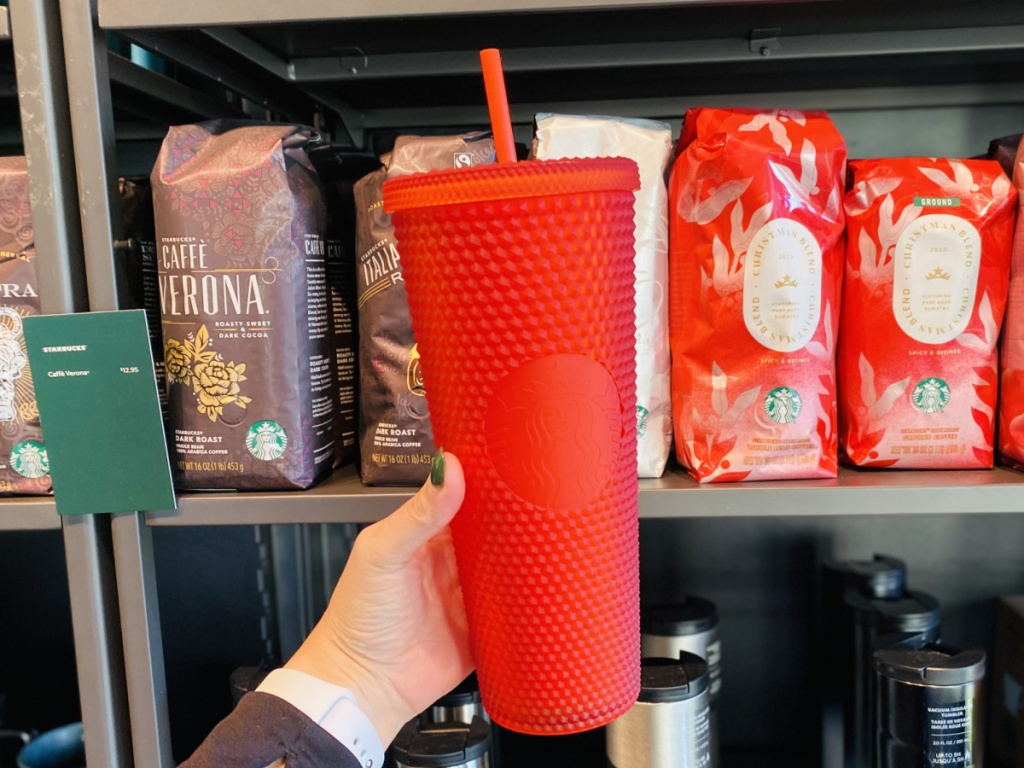 hand holding red studded matte cup at starbucks