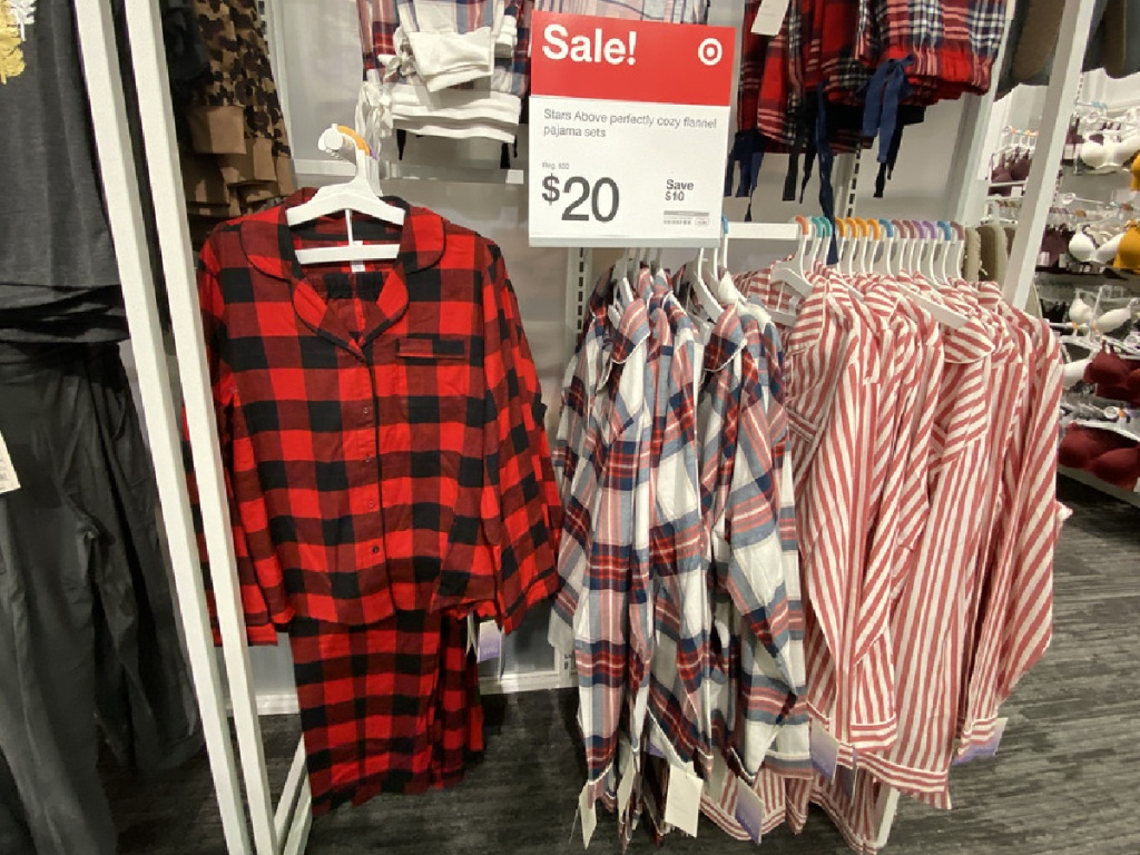 women's flannel pajama sets hanging in store
