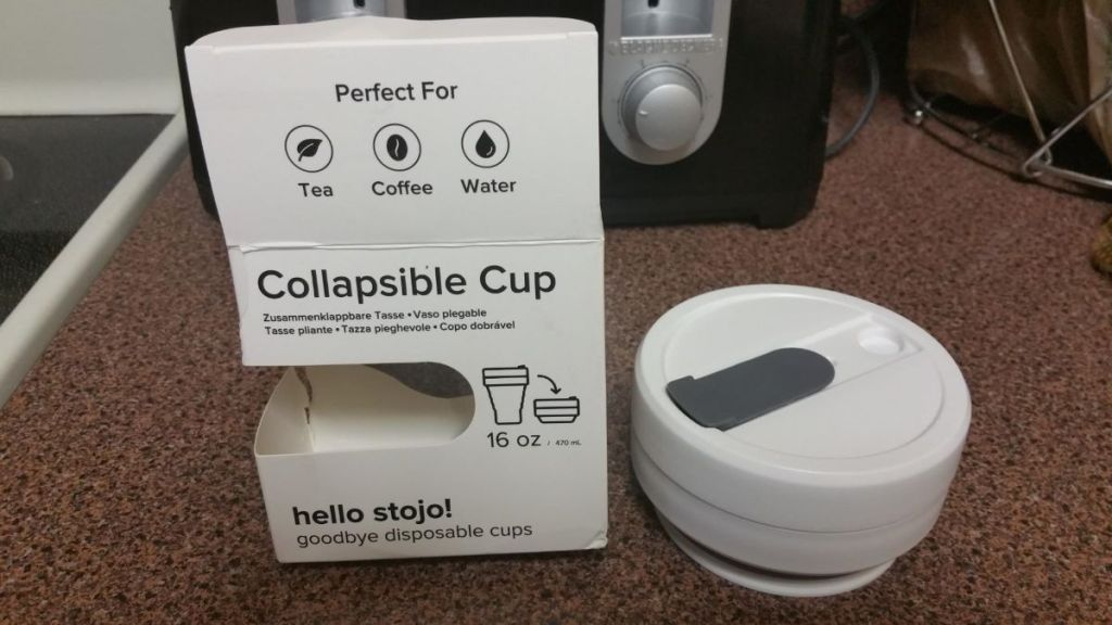 collapsible cup next to package