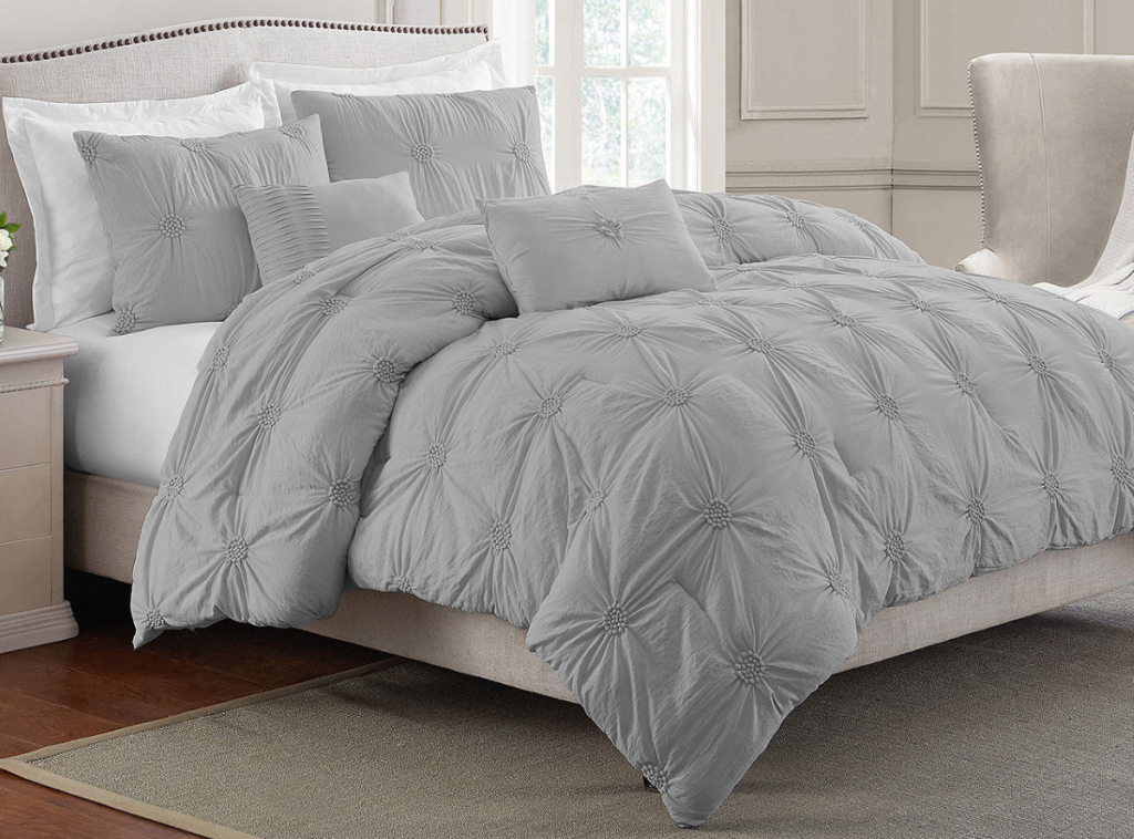 bedroom with a large bed and a gray comforter on the bed