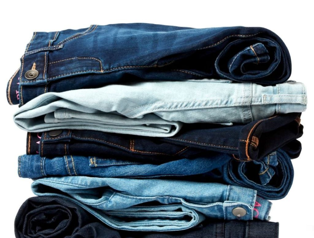 stack of kids jeans