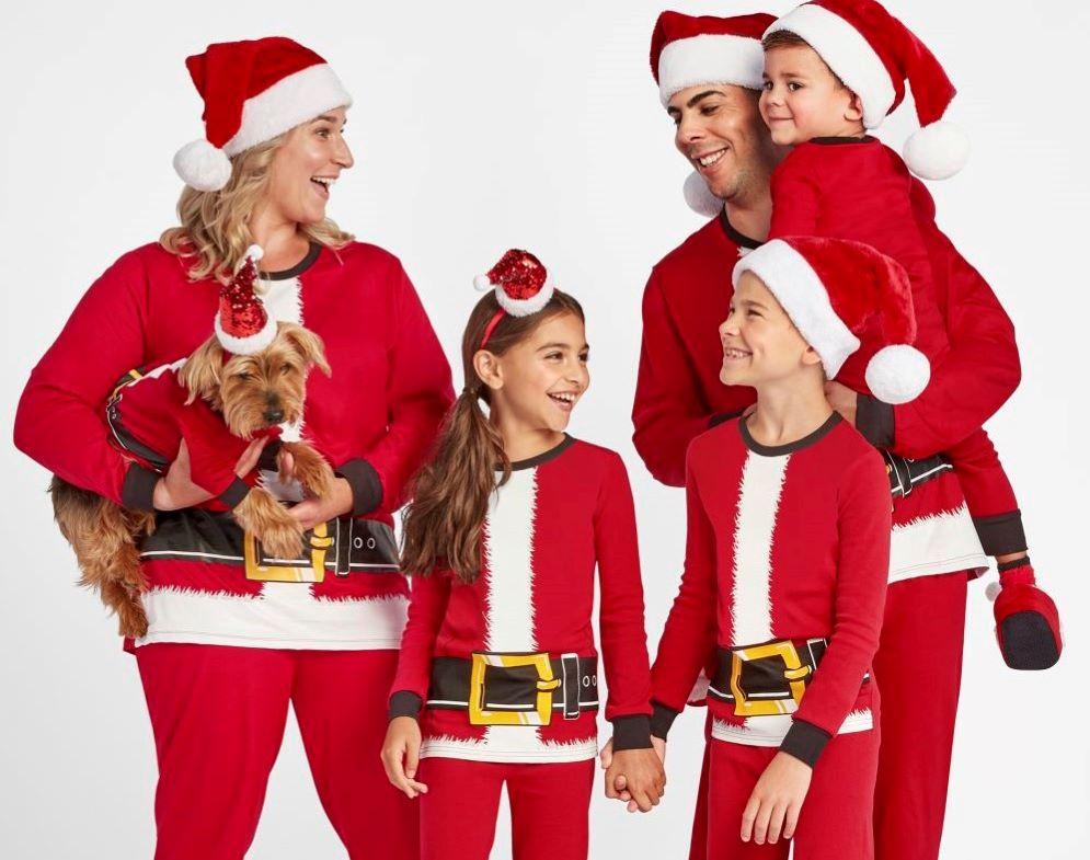 family wearing matching Santa pajamas