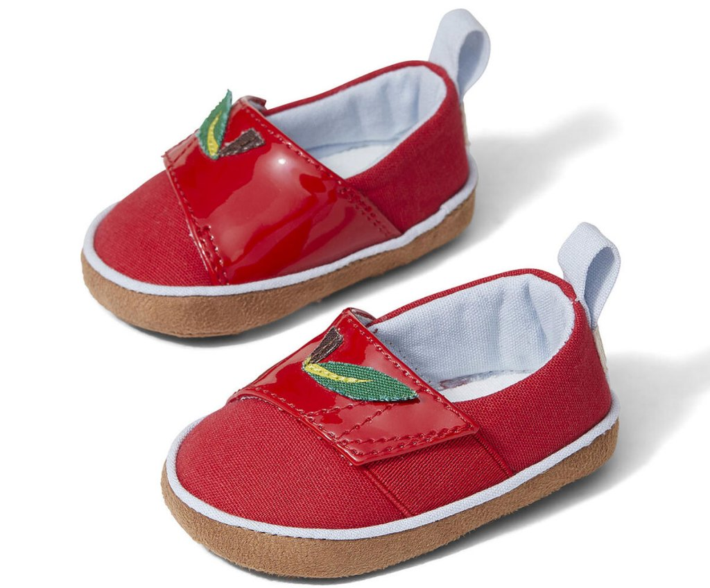 pair of red kids tiny toms with velcro tops and apple leaves on top