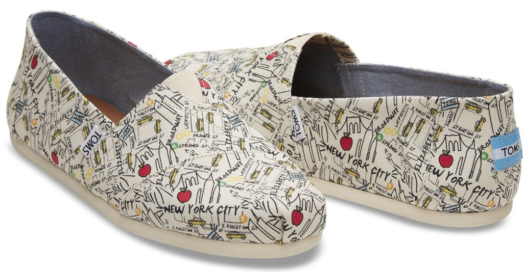 pair of white classic toms covered in a map of new york city
