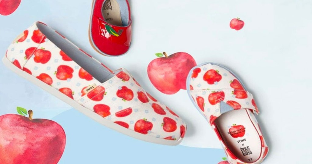kids and adult size pairs of toms shoes with red apple print