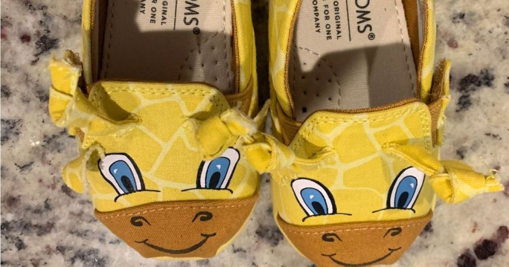 TOMS Giraffe slip on shoes on marble surface