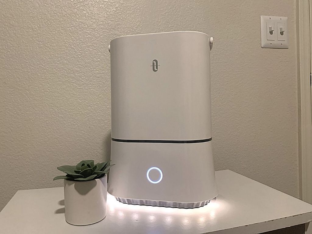 white humidifier with night light on white stand