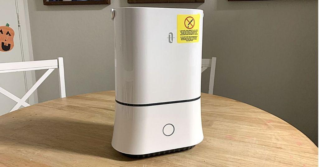 white humidifier on kitchen table
