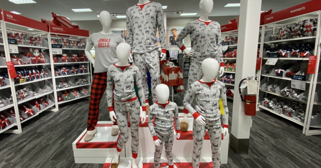 mannequins wearing holiday pajamas in store