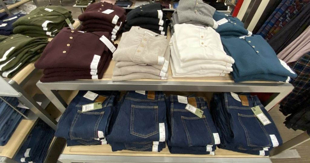 Layering jeans and tops on shelves