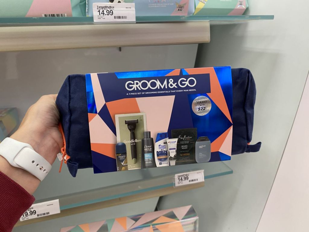 hand holding a men's grooming bag