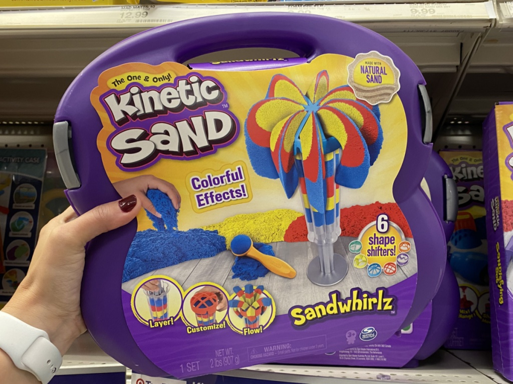 hand holding kinetic sand kit in target